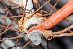 Details of the center of the bicycle wheel. Skewers, fork and nut in shallow focus. Details of the center of the bicycle wheel. Skewers, fork and nut in shallow royalty free stock images