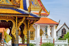 Details of Classical Thai architecture in National Museum of Bangkok, Thailand. There is the Thai's Rama Statue in the background Royalty Free Stock Photo