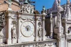 Clock in the Court of the Ducal Palace of Venice, Italy stock images