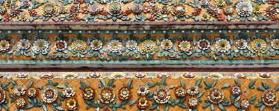 Details of colorful floral design tile decorated. Details of ornate colorful tile decorated at wat Pho, Thailand Stock Photography