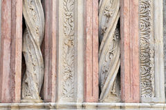 Details of the columns in marble on the facade of the Siena Baptistery Royalty Free Stock Photo