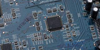 Details and components of a blue printed circuit board stock image
