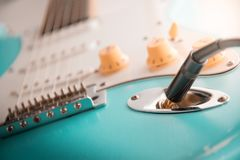 Details and connection of guitar and wire cable jack. Tone and volume controls royalty free stock photography