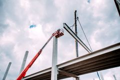 Details of construction site with crane lifting prefabricated concrete framework stock images