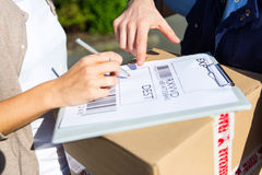 Details of a customer signing delivery note Stock Images