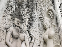 Details of dancing Apsara at Angkor wat. Details of sandstone carving of dancing Apsara on the wall of Angkor wat Royalty Free Stock Photography