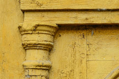 Details of the decor on yellow old door Stock Images