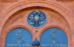 Details of the decoration of the brick wall coat of arms of Russia-the Imperial symbol of the double-headed eagle stock images