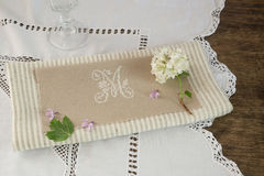 Details decoration saucers a tablecloth embroidered with letter M Royalty Free Stock Photography