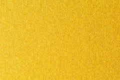 Details des goldenen Beschaffenheitshintergrundes Goldfarbfarbenwand Goldener Luxushintergrund und Tapete Goldfolie oder Lizenzfreies Stockbild