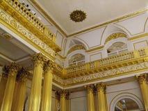 Details des Goldinnenraums im Einsiedlereipalast Heiligen Peterburg Stockfoto
