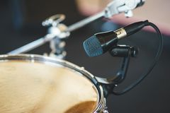 Details of the drum set on the scene close-up. Musical instruments and musical performance. Drums.  Hi-Hat, tam-tam, Microphone close up royalty free stock images