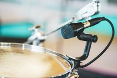 Details of the drum set on the scene close-up. Musical instruments and musical performance. Drums.  Hi-Hat, tam-tam, Microphone close up royalty free stock image