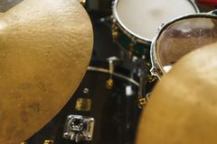 Details of the drum set on the scene close-up. Musical instruments and musical performance. Drums.  Hi-Hat, tam-tam, Microphone close up stock images