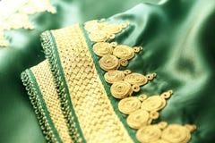 Details eines grünen marokkanischen Kaftans Stockbild