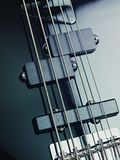 Details of electric bass, pickups and cords Stock Photography