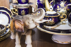 Details of elegant blue tableware and elephant statuette Royalty Free Stock Photo