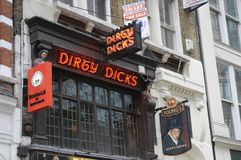 Dirty Dicks pub in London,UK. Details of the entrance to the 3-floor pub with wood panelling, named after notoriously dirty, local 18th-century warehouse Royalty Free Stock Photos