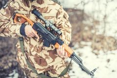Details of equipment and gun on ranger - War, hunting or protection concept with man Royalty Free Stock Photo