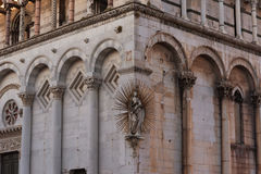 Details of the facade of Church San Michele in Foro Saint Michael in Lucca, Italy. Stock Photos