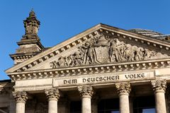 Details of the Facade of the German Parliament. Letters on the German parliament building, the Reichstag at Berlin, Germany, reading Dem Deutschen Volke  (To The Royalty Free Stock Photography