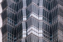 Details of the facade of a modern skyscraper made of glass and steel closeup. Shanghai World Financial Center Royalty Free Stock Photography