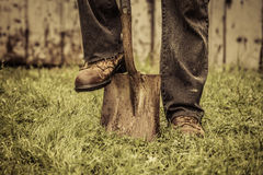 Details of feet and Shovel Royalty Free Stock Image