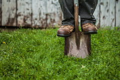 Details of feet and Shovel Stock Images