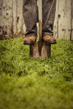 Details of feet and Shovel. In front of Barn Stock Image