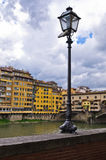 Details of Florence architecture along banks of river Arno near Ponte Vecchio bridge, Tuscany Royalty Free Stock Images