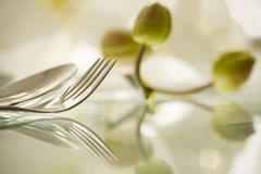 Details of a fork and spoon on reflecting surface Stock Photography