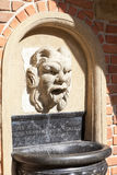 Details of fountain with mascaron in the courtyard of Collegium  Maius, Krakow, Poland. Details of fountain with mascaron in the courtyard of Collegium Maius Stock Photo