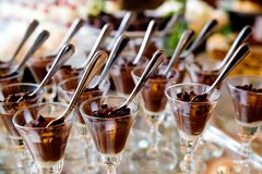 Free Details From A Wedding Dessert Table - Chocolate Mousse In Fancy Glasses With Spoons Royalty Free Stock Photos - 141777468