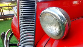 Details of the front headlight lamp red vintage classic car Stock Image