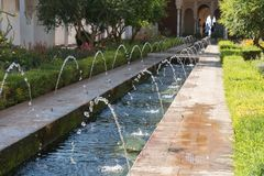Generalife`s Gardens Of Granada, Andalucia Spain. Details Of Generalife`s Gardens Of Granada, Fountains And Pond Royalty Free Stock Photos