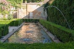 Generalife`s Gardens Of Granada, Andalucia Spain. Details Of Generalife`s Gardens Of Granada, Fountains And Pond Stock Photo