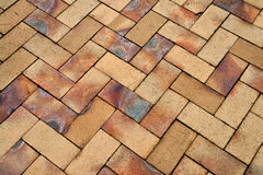 Details of geometric brown stone garden tiles Stock Images