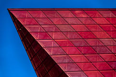 Details of glass facade with colorful red and Stock Photography