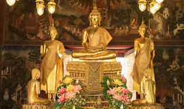 Details of golden buddha statue with tales of the lord Buddha`s Stock Photos