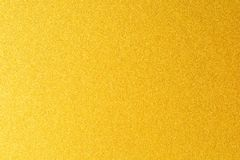Details of golden texture background. Gold color paint wall. Luxury golden background and wallpaper. Gold foil or royalty free stock images