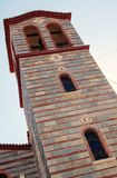 Greek Orthodox Church. Details of Greek Orthodox church, part of building with focus on tower with bells Stock Photos