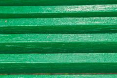Details of a green bench, background of boards painted in green color. Details of a green bench, background of boards painted in green color royalty free stock photos