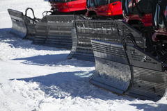 Details of a group of Snow-grooming machine on snow Royalty Free Stock Images