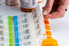 Organizing prescriptions for the week Royalty Free Stock Image