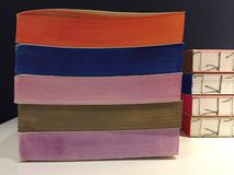 Details of handmade books of different multi colored papers. Notebooks. Details of handmade books of different multi colored papers. Colorful notebooks royalty free stock images