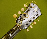 Details of headstock of mandolin. With olive background Stock Image