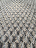 Details of the honeycomb mesh fabric upholstery is a device of motorcycle. Royalty Free Stock Photo