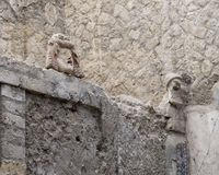 Details of House 22 in the remains of Herculaneum Parco Archeologico di Ercolano. Pictured are small heads in House Number 22 in the remains of Herculaneum in Stock Photo