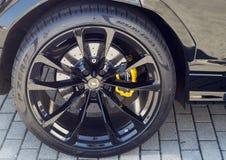 Lamborghini Urus. Details of the immense 23` wheels and the very powerful yellow brake calipers of the Lamborghini Urus royalty free stock photo