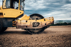 Details of industrial road soil compactor, vibratory roller and heavy duty machinery during highway construction. Close up details of industrial road soil Stock Photo